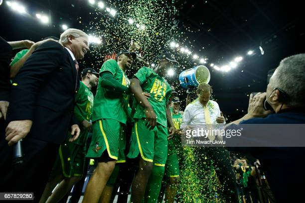 The Oregon Ducks celebrate with confetti after defeating the Kansas Jayhawks during the 2017 NCAA Men's Basketball Tournament held at Sprint Center...