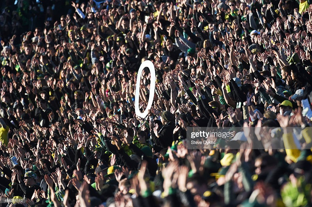 The Oregon Ducks fans cheer during the third quarter of the game against the USC Trojans at Autzen Stadium on November 21 2015 in Eugene Oregon The...