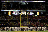 The Oregon Ducks huddle before the College Football Playoff National Championship Game at ATT Stadium on January 12 2015 in Arlington Texas