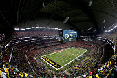 The Oregon Ducks kick off the ball in the second half to the Ohio State Buckeyes during the College Football Playoff National Championship Game at...