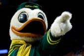 The Oregon Ducks mascot points against the Wisconsin Badgers during the third round of the 2014 NCAA Men's Basketball Tournament at BMO Harris...