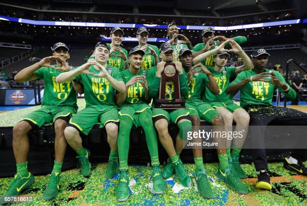 The Oregon Ducks pose after defeating the Kansas Jayhawks 7460 during the 2017 NCAA Men's Basketball Tournament Midwest Regional at Sprint Center on...
