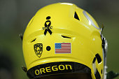 The Oregon Ducks wear a black ribbon on their helmets honoring the victims of the shooting at Umpqua Community College in Roseburg Oregon as they...