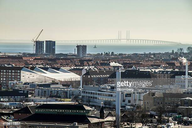 The Oresund bridge stands beyond residential and commercial buildings on the city skyline seen from the 'Vor Frue Kirch' church tower in Copenhagen...
