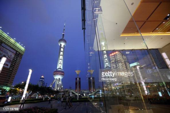 The Oriental Pearl Tower center left stands at night in the Lujiazui district of Shanghai China on Friday June 28 2013 China's President Xi Jinping...