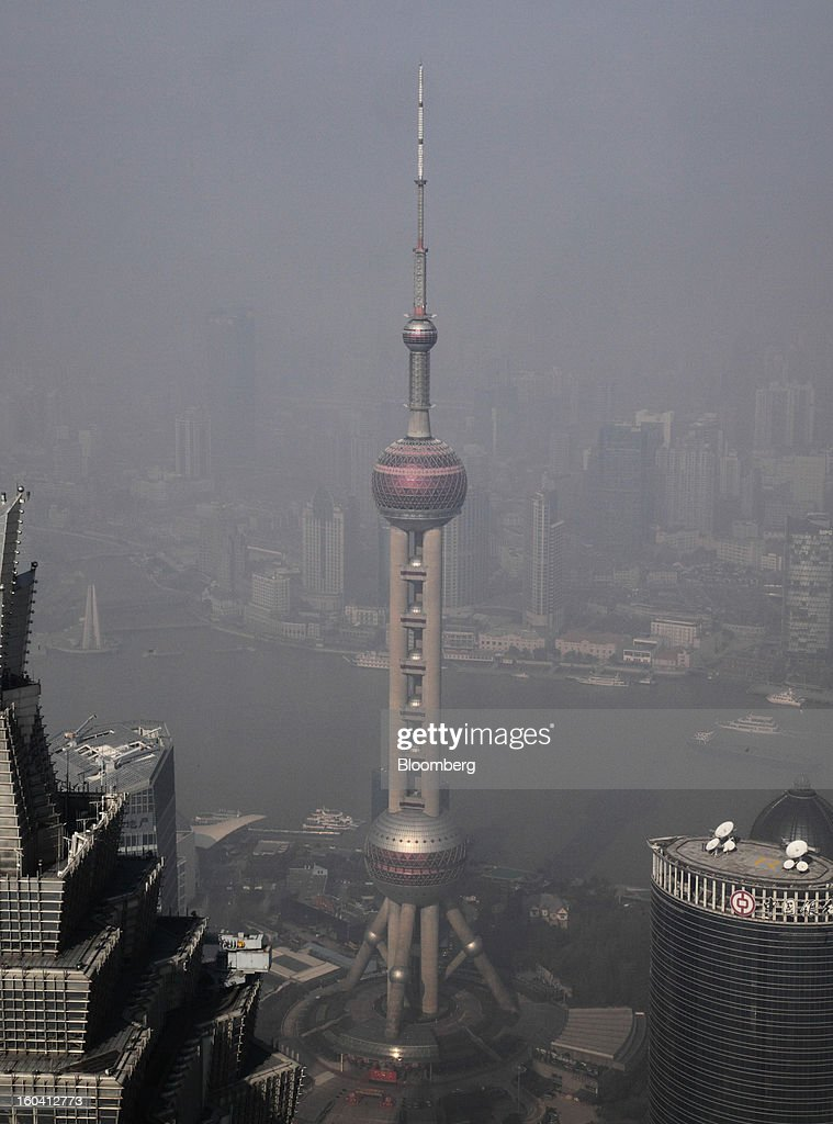 The Oriental Pearl Tower, center, stands among other commercial buildings in the Pudong area of Shanghai, China, on Wednesday, Jan. 30, 2013. China's economic growth accelerated for the first time in two years as government efforts to revive demand drove a rebound in industrial output, retail sales and the housing market. Photographer: Tomohiro Ohsumi/Bloomberg via Getty Images