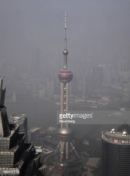 The Oriental Pearl Tower center stands among other commercial buildings in the Pudong area of Shanghai China on Wednesday Jan 30 2013 China's...