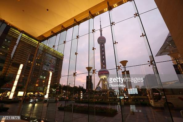 The Oriental Pearl Tower is seen from the foyer of a commercial building at dusk in the Lujiazui district of Shanghai China on Friday June 28 2013...