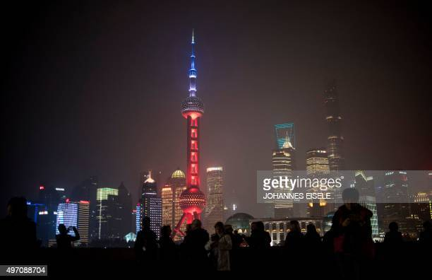 The Oriental Pearl TV Tower in the Lujiazui Financial District in Pudong is lit in red white and blue resembling the colours of the French flag in...