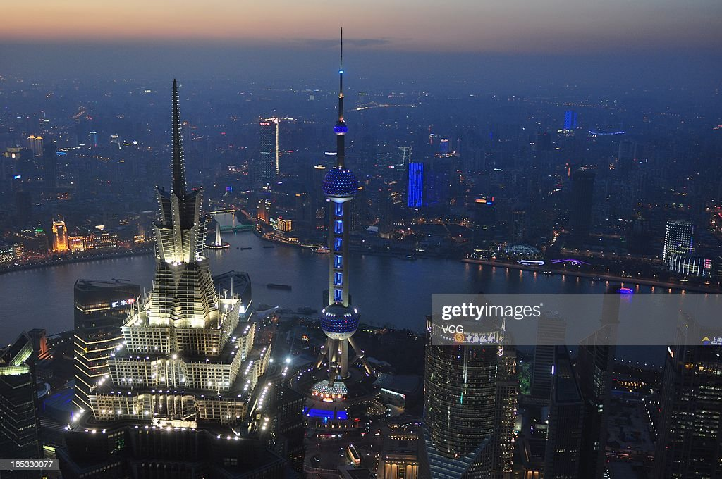 The Oriental Pearl TV Tower (C) is illuminated in blue on World Autism Awareness Day on April 2, 2013 in Shanghai, China. World Autism Awareness Day falls on April 2 every year.