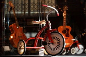 The original child's tricycle from the Omen film is displayed at Bonham's auctioneers on December 10 2010 in London England The tricycle estimated at...