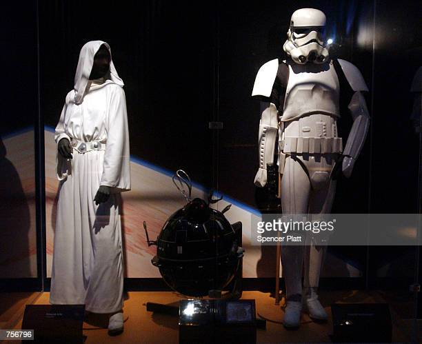 The original costumes for Princess Leia and an Imperial Storm Trooper stand on display April 4 2002 at the exhibit 'Star Wars The Magic of the Myth'...