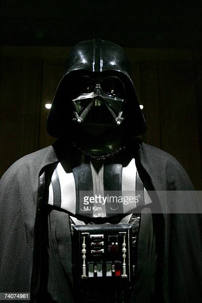 The original costumes for Star Wars character Darth Vader stand on display at 'Star Wars The Exhibition' at County hall on May 04 2007 in London...