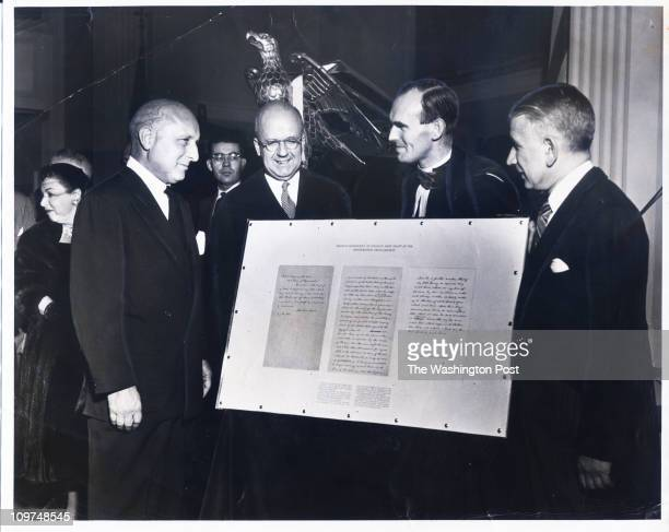 The original draft of the Emancipation Proclamation is presented as part of the dedication of the New York Avenue Presbyterian Church Left to right...