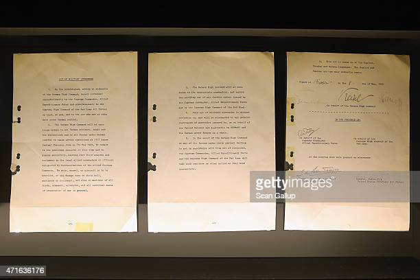 The original Englishlanguage document signed by German military leaders finalizing Nazi Germany's surrender during World War II lies on display at...
