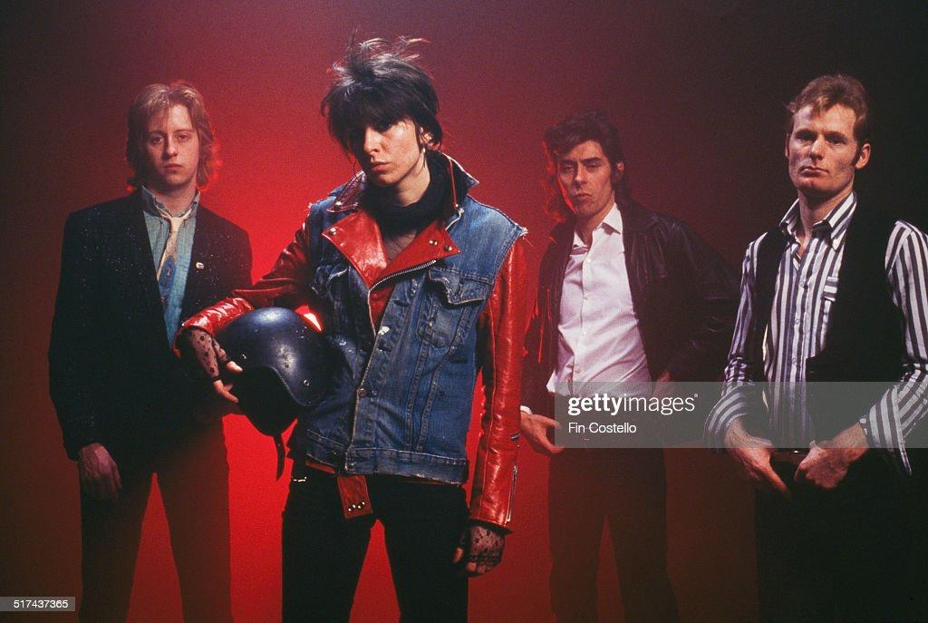 The original lineup of rock group The Pretenders UK 1979 Left to right guitarist James Honeyman Scott singer and rhythm guitarist Chrissie Hynde...