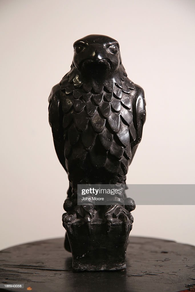 The original Maltese Falcon stands on display before being auctioned by the Guernsey's Auction House on November 4, 2013 in New York City. The statuette from the 1941 film noir classic The Maltese Falcon, starring Humphrey Bogart and Mary Astor, will be auctioned on November 7 at New York City's Arader Galleries.
