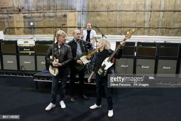 The original members of Status Quo Rick Parfitt Francis Rossi Alan Lancaster and John Coghlan practice at Sheperton Studios in Surrey ahead of...