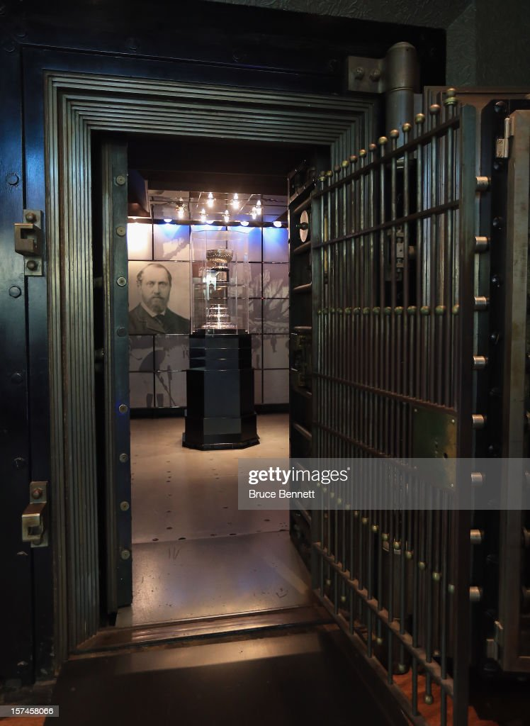 The original Stanley Cup along with a portrait of Lord Stanley of Preston resides in a vault beside the Great Hall prior to the HHoF induction press conference and photo opportunity at the Hockey Hall of Fame on November 12, 2012 in Toronto, Canada.