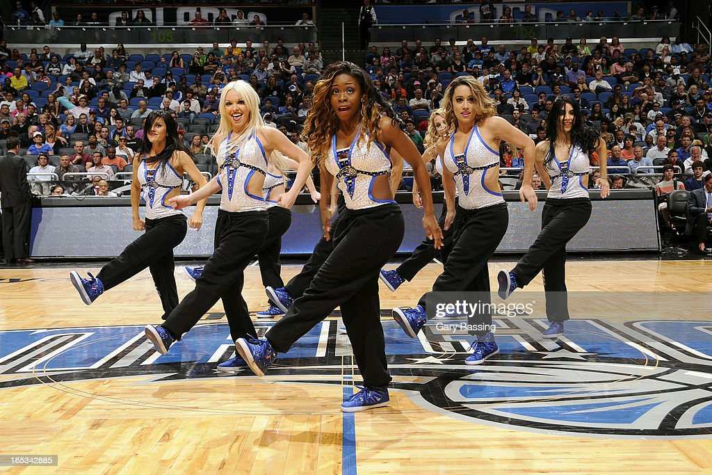 The Orlando Magic dance team performs during halftime of the game against the Washington Wizards on March 29, 2013 at Amway Center in Orlando, Florida.