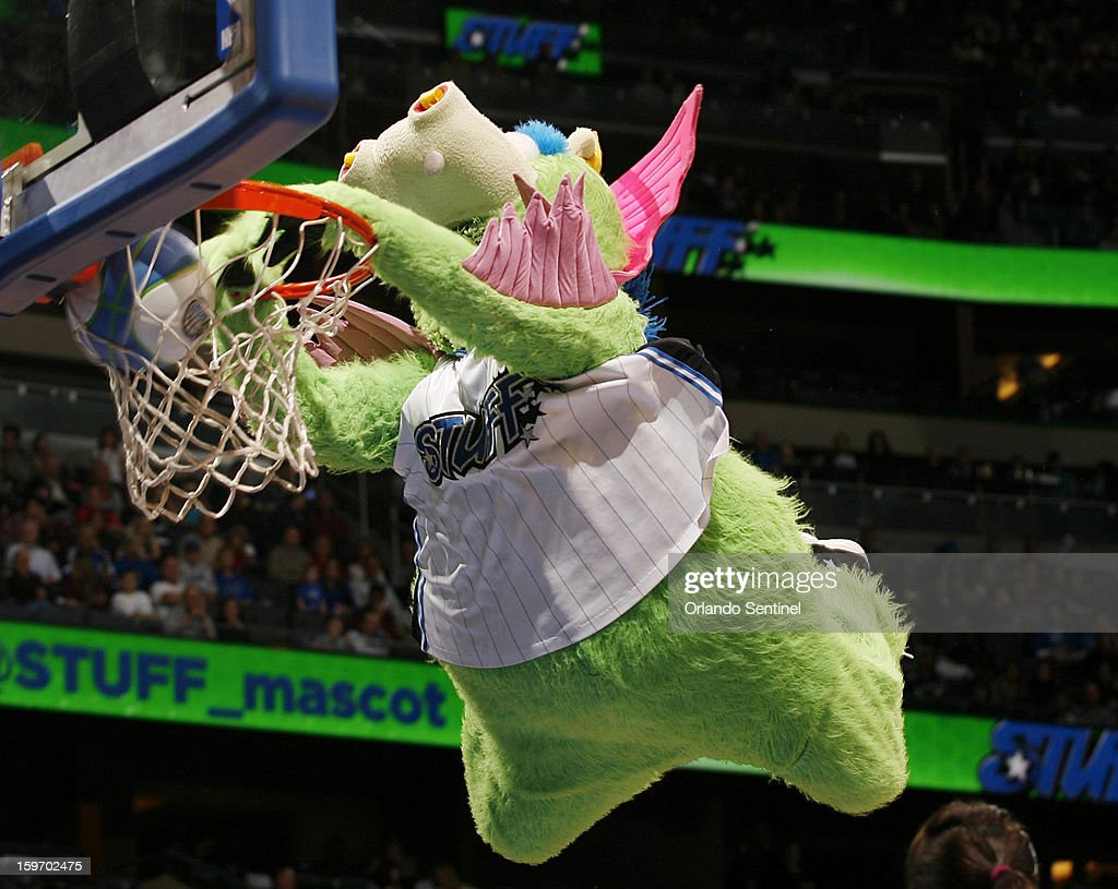 STUFF, the Orlando Magic mascot, dunks during a time out during action against the Charlotte Bobcats at the Amway Center in Orlando, Florida, on Friday, January 18, 2013. Charlotte won, 106-100.