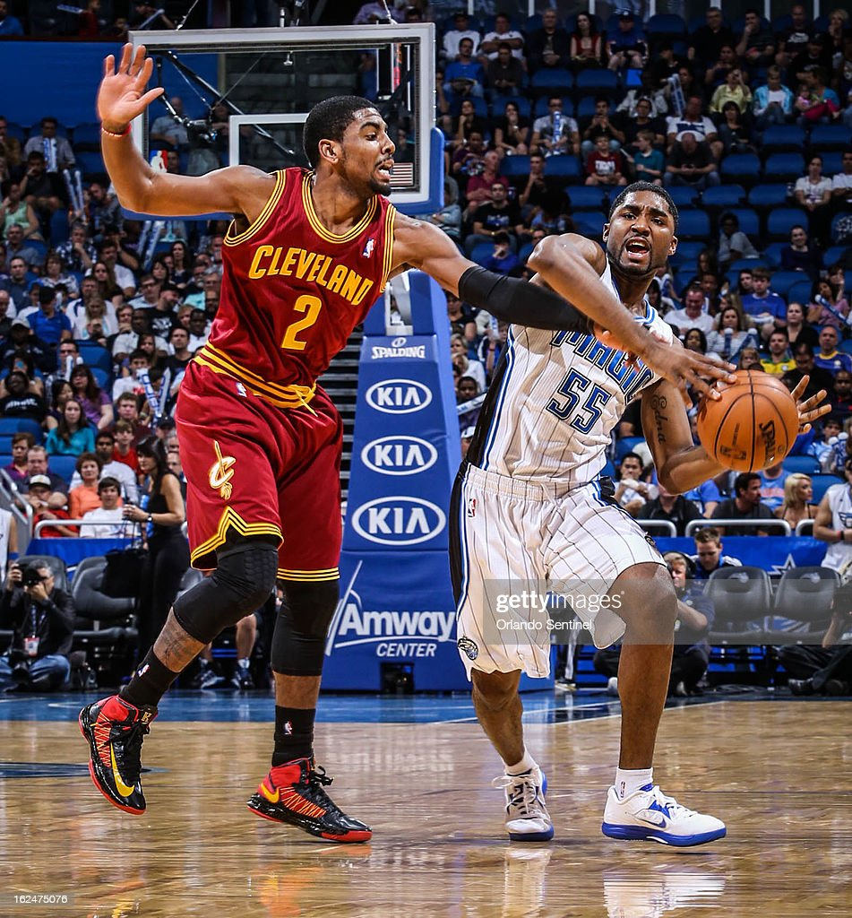 The Orlando Magic's E'Twaun Moore (55) is fouled by the Cleveland Cavaliers' Kyrie Irving (2) as he drives the ball down court during third-quarter action at Amway Center in Orlando, Florida, on Saturday, February 23, 2013. Cleveland topped Orlando, 118-94.