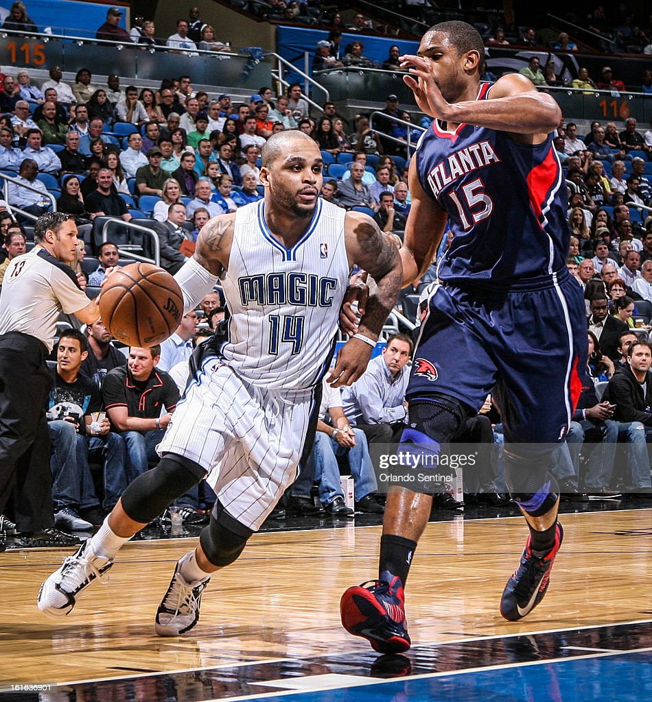 The Orlando Magic's Jameer Nelson (14) drives against the Atlanta Hawks' Al Horford (15) in second-quarter action at Amway Center in Orlando, Florida, on Wednesday, February 13, 2013. Atlanta defeated Orlando, 108-76.
