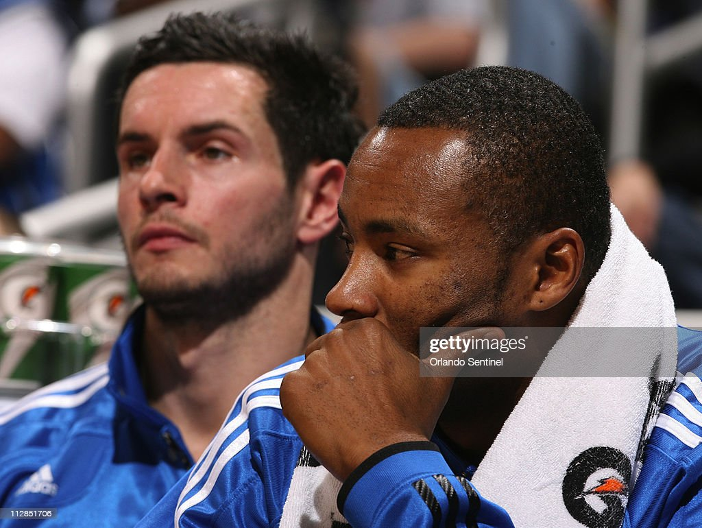 The Orlando Magic s J J Redick left and Rashard Lewis sit on