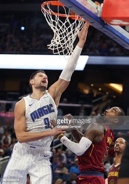 The Orlando Magic's Nikola Vucevic scores over the Cleveland Cavaliers' JR Smith in preseason action at the Amway Center in Orlando Fla on Friday Oct...