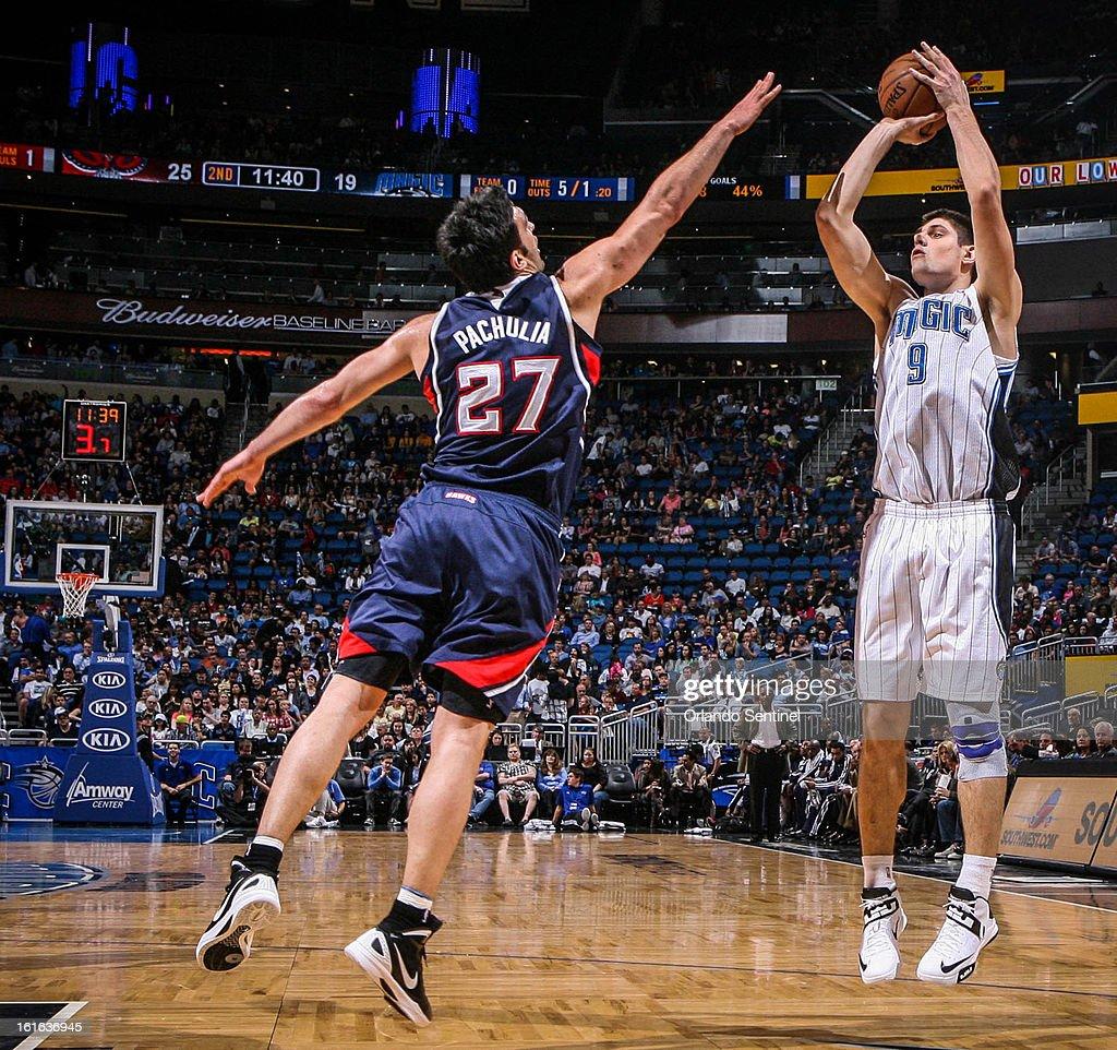 The Orlando Magic's Nikola Vucevic (9) shoots over the Atlanta Hawks' Zaza Pachulia (27) in second-quarter action at Amway Center in Orlando, Florida, on Wednesday, February 13, 2013. Atlanta defeated Orlando, 108-76.