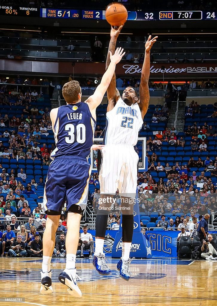 The Orlando Magic's Solomon Jones (22) shoots over the Memphis Grizzlies' Jon Leuer (30) during first-half action in a preseason game at Amway Center in Orlando, Florida, on Friday, October 18, 2013.