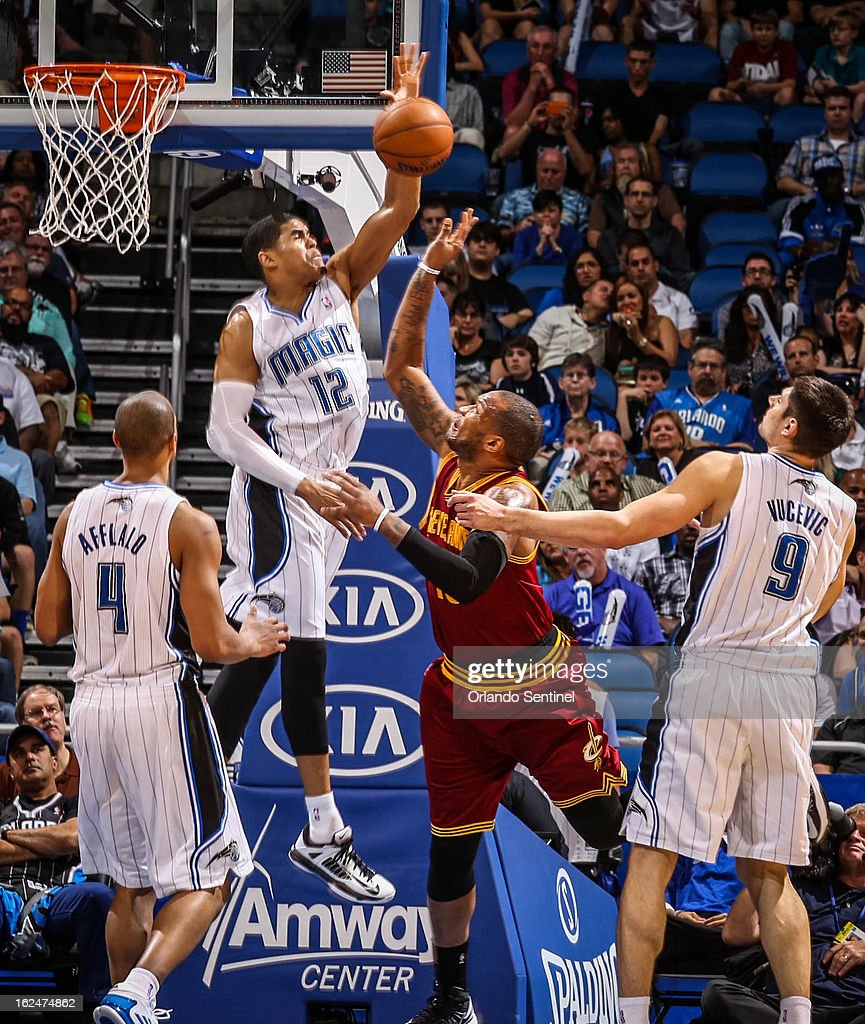 The Orlando Magic's Tobias Harris (12) blocks a shot by the Cleveland Cavaliers' Marreese Speights (15) during the fourth quarter at Amway Center in Orlando, Florida, on Saturday, February 23, 2013. Cleveland topped Orlando, 118-94.