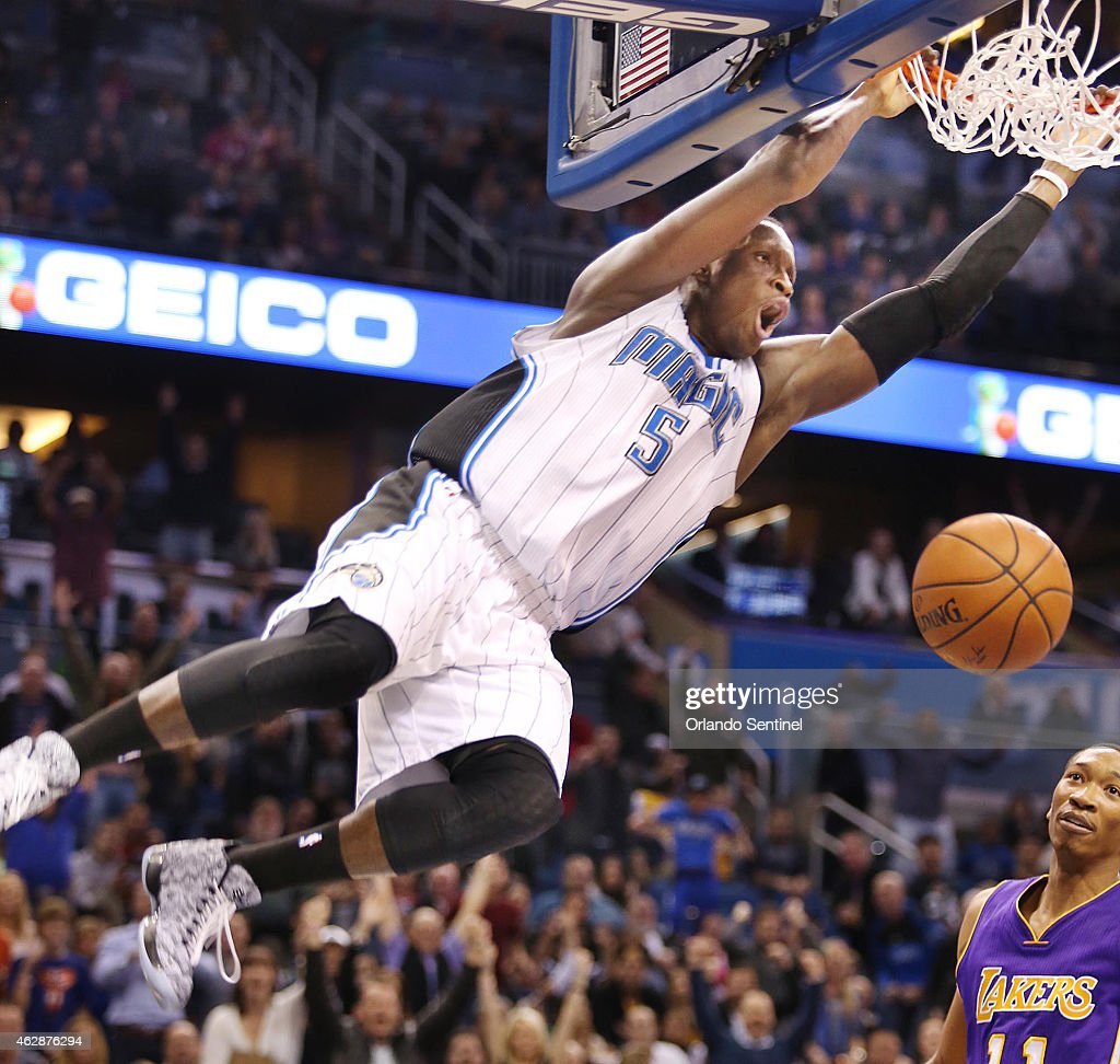 The Orlando Magic's Victor Oladipo throws down a dramatic slam dunk over the Los Angeles Lakers' Wesley Johnson to seal the victory late in overtime...
