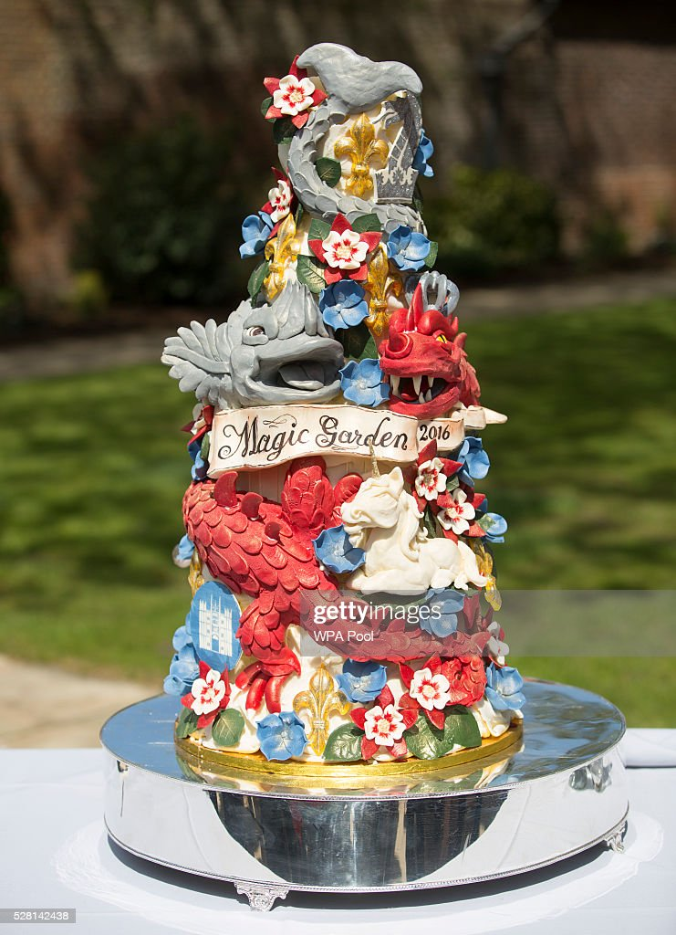 The ornate cake decorated with dragons and magical creatures baked especially for the opening is displayed as Catherine, Duchess of Cambridge officially opens The Magic Garden at Hampton Court Palace on May 4, 2016 in London, England.