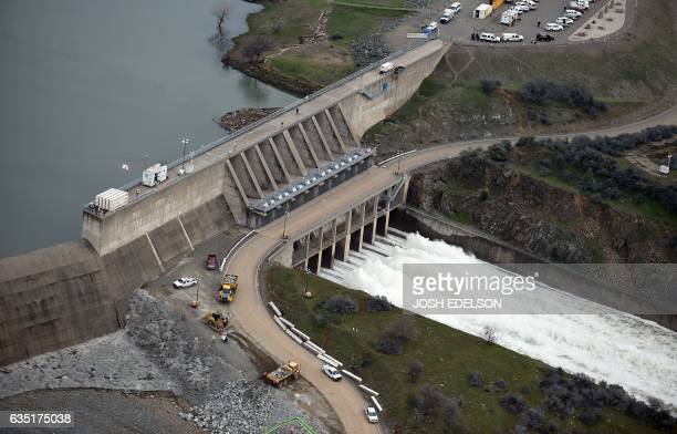 The Oroville Dam releases 100000 cubic feet of water per second down the main spillway in Oroville California on February 13 2017 Almost 200000...