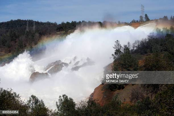 The Oroville Dam spillway overflows with runoff in Oroville California on February 14 2017 A sheriff lifted a mandatory evacuation order in northern...
