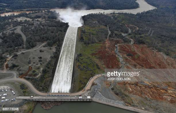 The Oroville Dam spillway releases 100000 cubic feet of water per second down the main spillway in Oroville California on February 13 2017 Almost...