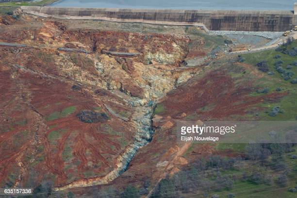 The Oroville Lake emergency spillway and the erosion damage below it is seen from the air on February 13 2017 in Oroville California The erosion...