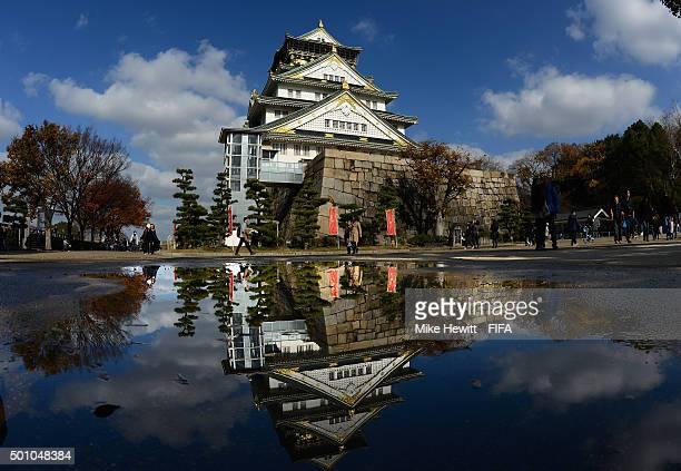 The Osaka Castle is reflected in a rain puddle on December 12 2015 in Osaka Japan