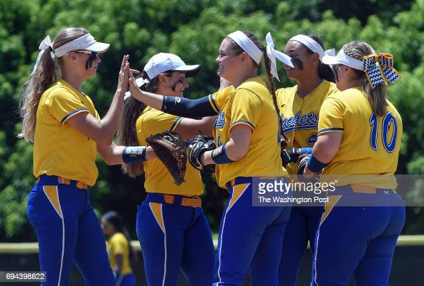 The Osbourn team celebrates after an out during the Virginia 6A State Softball Semifinal game between Osbourn Park and Grassfield at Westfield High...
