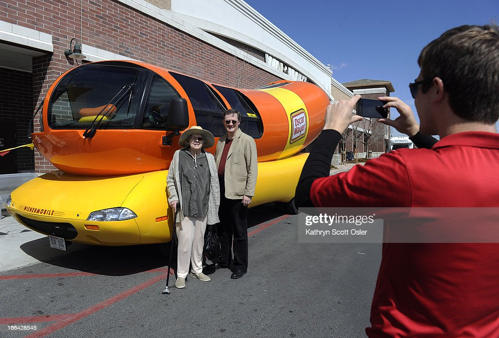 The Oscar Mayer Wienermobile rolls through the metro area on its voyage across the country celebrating the 25th anniversary of having the giant hot dog piloted by recent college grads like 'Deli' Eliot Pattee, right, taking a photo of Andrew Grieb and his mother Alice Nutt. The grads, who are part of the 'hotdogger tradition', must attend two weeks of 'Hotdog High' in Madison Wisconsin and serve as drivers and ambassadors of all things Oscar Mayer for one year. There is still a chance to see the road dog before it hits the highway on its return to Wisconsin from 11 a.m.- 4 p.m Saturday at the Walmart at 440 Wadsworth Blvd. in Lakewood.