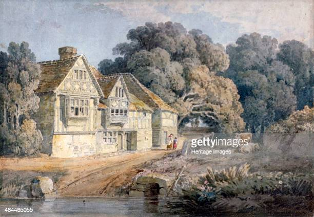 'The Ost House at Hastings Sussex' 19th century The Ost House sits on the bank of a river with figures walking past and cows nearby