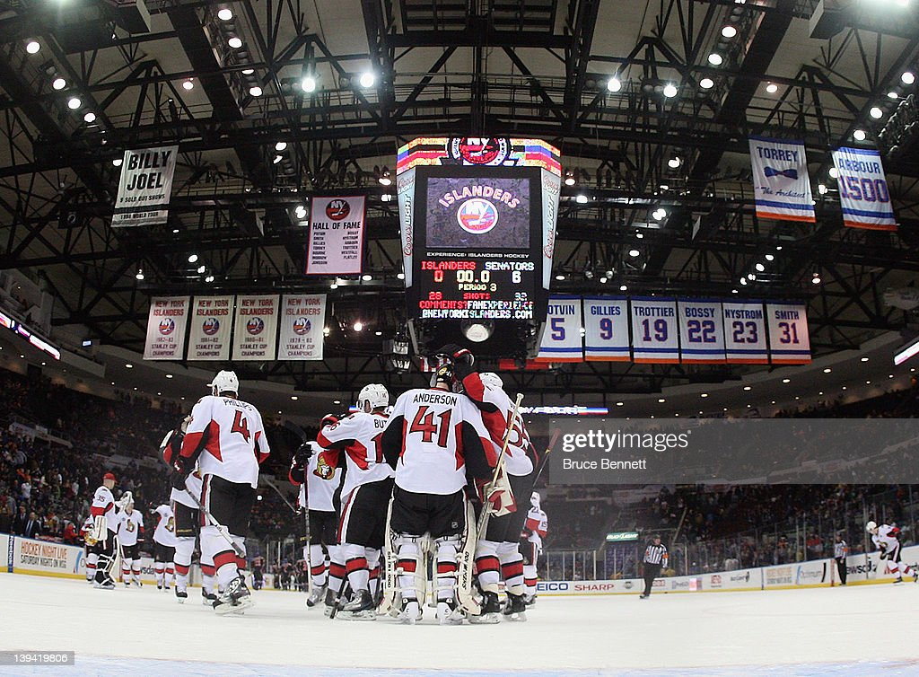 The Ottawa Senators and goaltender <a gi-track='captionPersonalityLinkClicked' href=/galleries/search?phrase=Craig+Anderson&family=editorial&specificpeople=211238 ng-click='$event.stopPropagation()'>Craig Anderson</a> #41 celebrate their 6-0 shutout over the New York Islanders at the Nassau Veterans Memorial Coliseum on February 20, 2012 in Uniondale, New York.