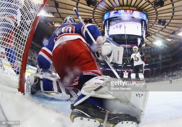 The Ottawa Senators celebrate a goal against Henrik Lundqvist of the New York Rangers in Game Three of the Eastern Conference Second Round during the...