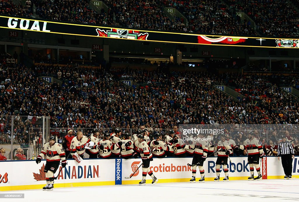 The Ottawa Senators celebrate a goal against the Vancouver Canucks during the 2014 Tim Hortons NHL Heritage Classic game at BC Place on March 2, 2014 in Vancouver, British Columbia, Canada.