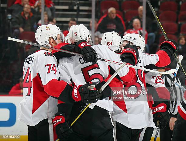 The Ottawa Senators celebrate a goal by Cody Ceci at 1714 of the third period against the New Jersey Devils at the Prudential Center on January 21...