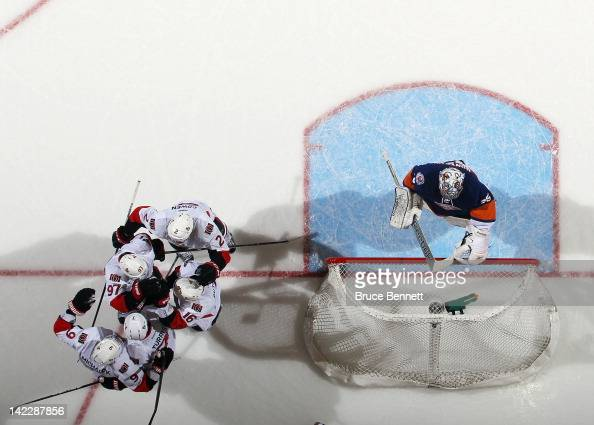 The Ottawa Senators celebrate a goal by Kyle Turris at 1640 of the first period against Al Montoya of the New York Islanders at the Nassau Veterans...