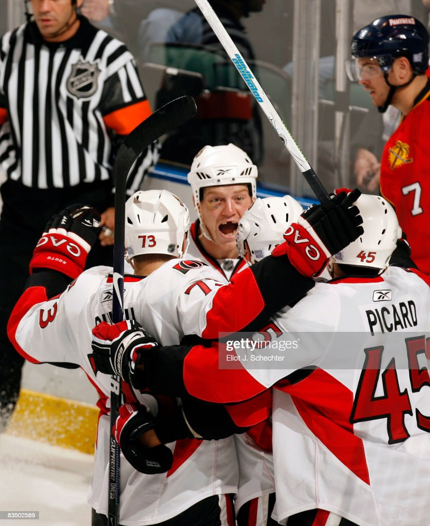 The Ottawa Senators celebrate a goal scored by teammate Chris Kelly against the Florida Panthers at the BankAtlantic Center October 30 2008 in...
