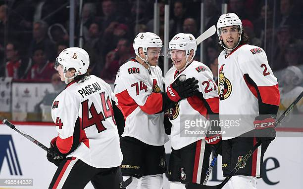 The Ottawa Senators celebrate after scoring a goal against the Montreal Canadiens in the NHL game at the Bell Centre on November 3 2015 in Montreal...