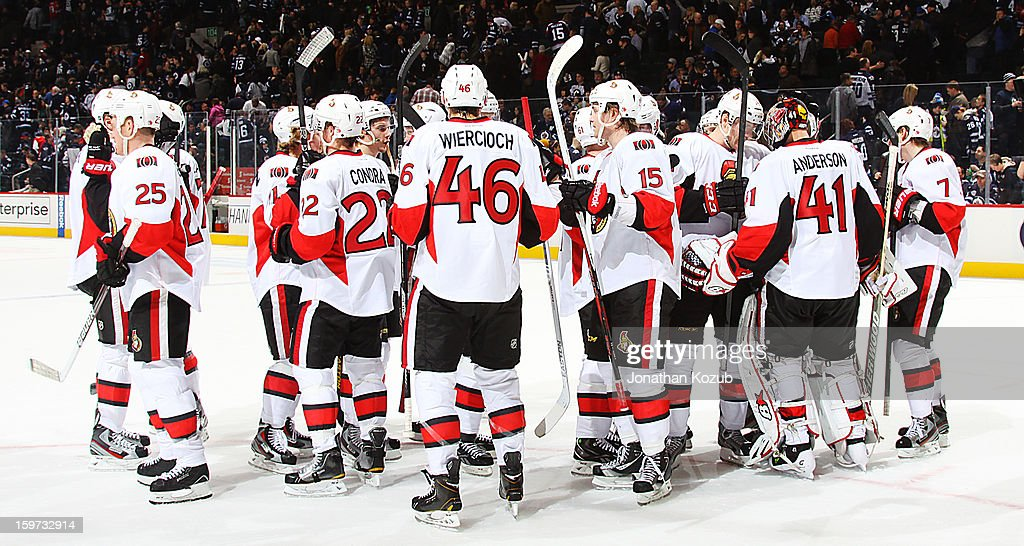 The Ottawa Senators celebrate as they gather on the ice following a 4-1 victory over the Winnipeg Jets at the MTS Centre on January 19, 2013 in Winnipeg, Manitoba, Canada.